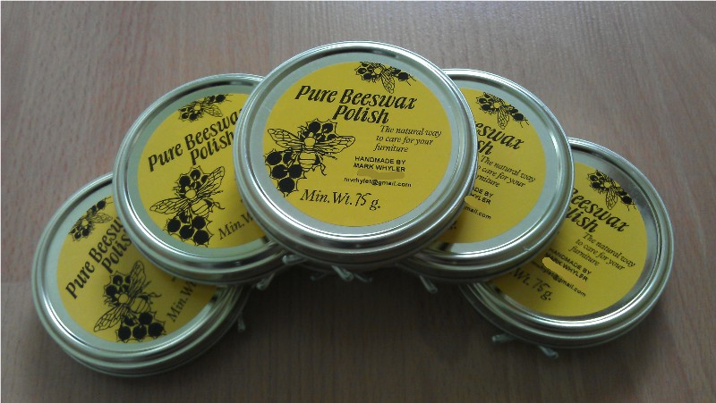 tins of beeswax polish